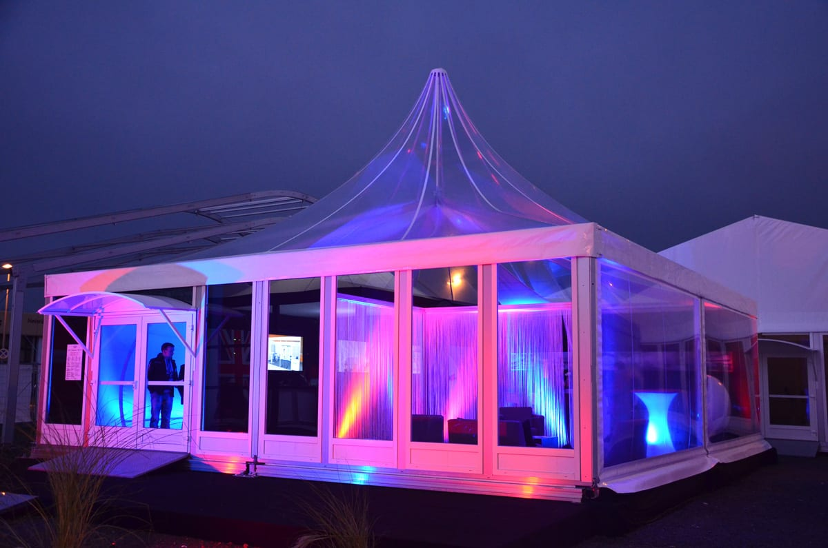A Pagoda tent lit up at a trade show event