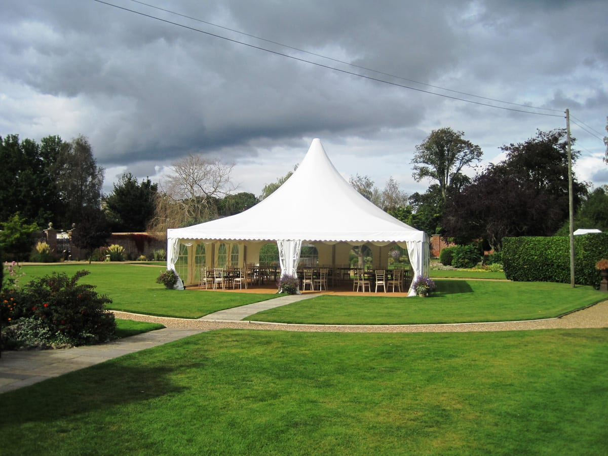 A Large pagoda tent providing a hospitality space in garden