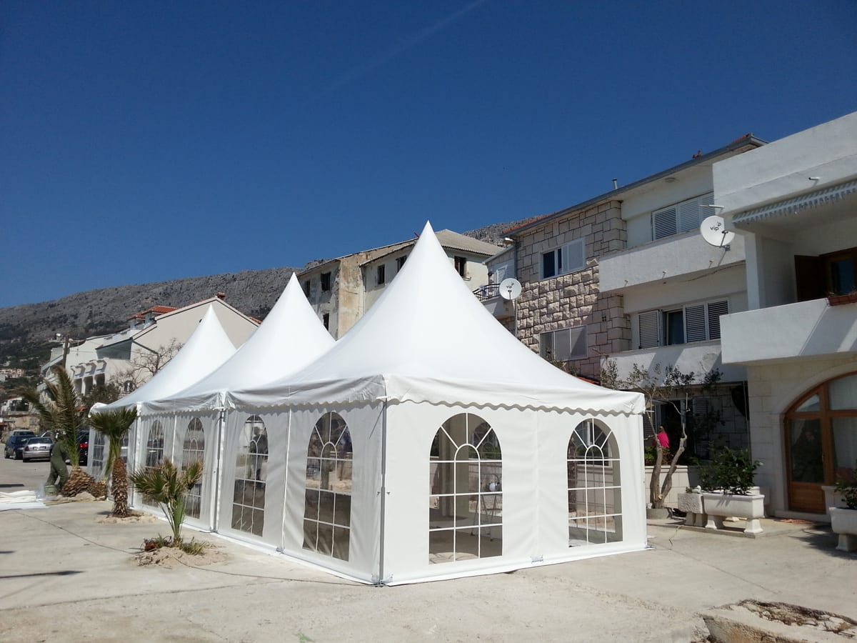 Multiple London Pagoda tents in residential street for a local event