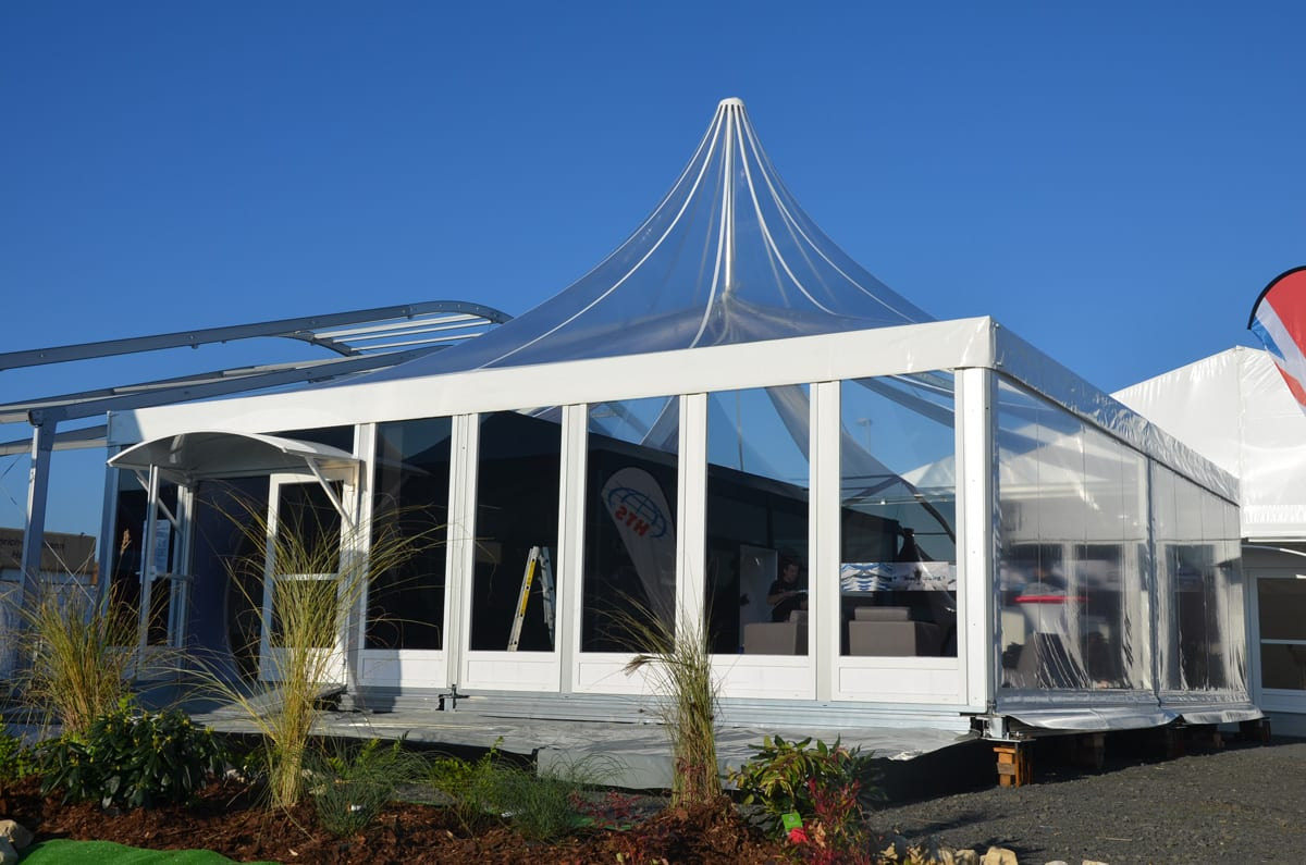 A Pagoda tent with a Scalloped Edge Roof Valance at a trade show