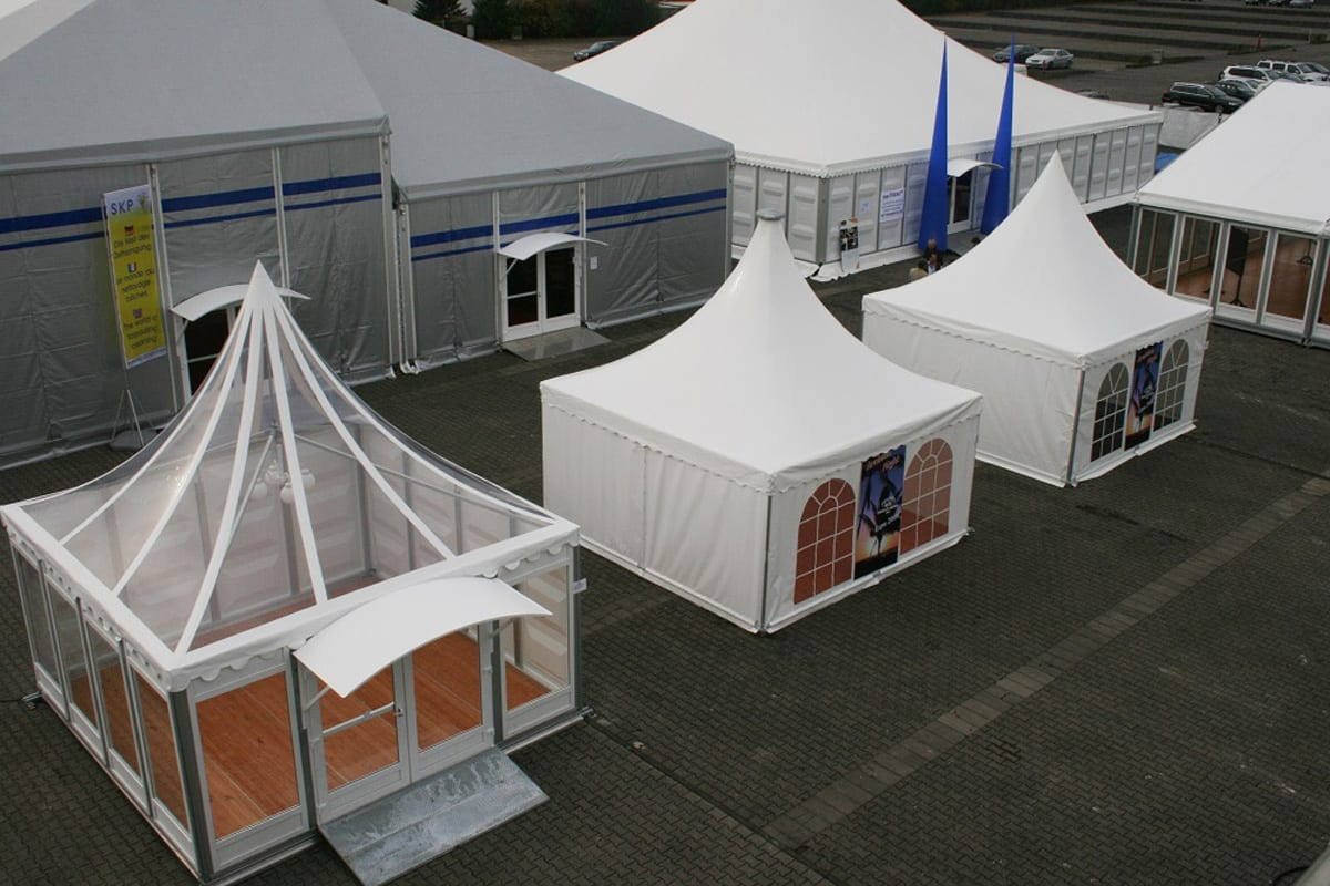 Multiple Pagoda tents with Scalloped Edge Roofs on disaply at an event show