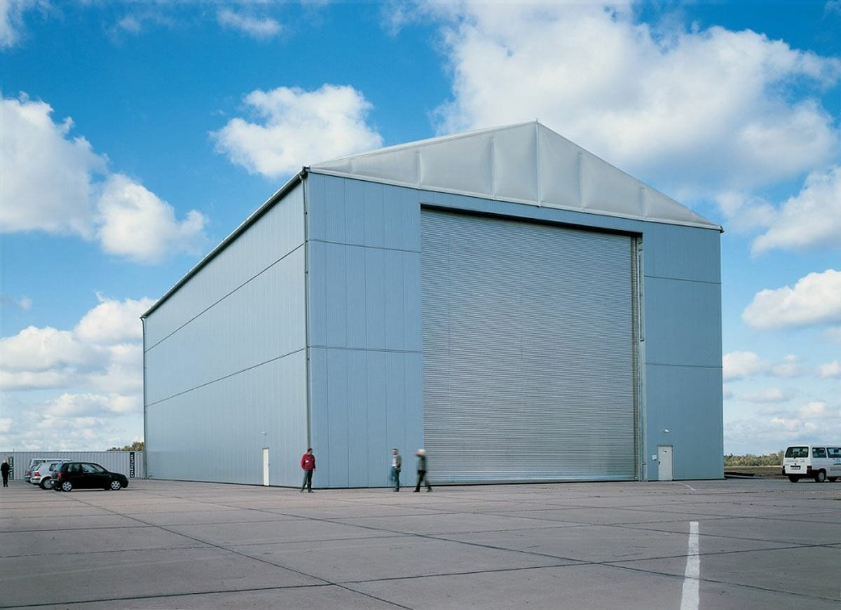 A large custom clear-span structure with a large steel shutter door