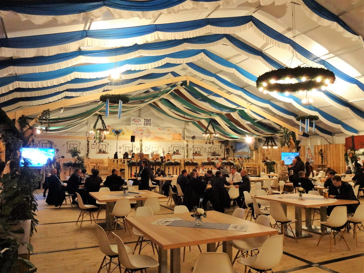 The interior of a HTS tentiQ GZ large party tent providing hospitality for a trade show