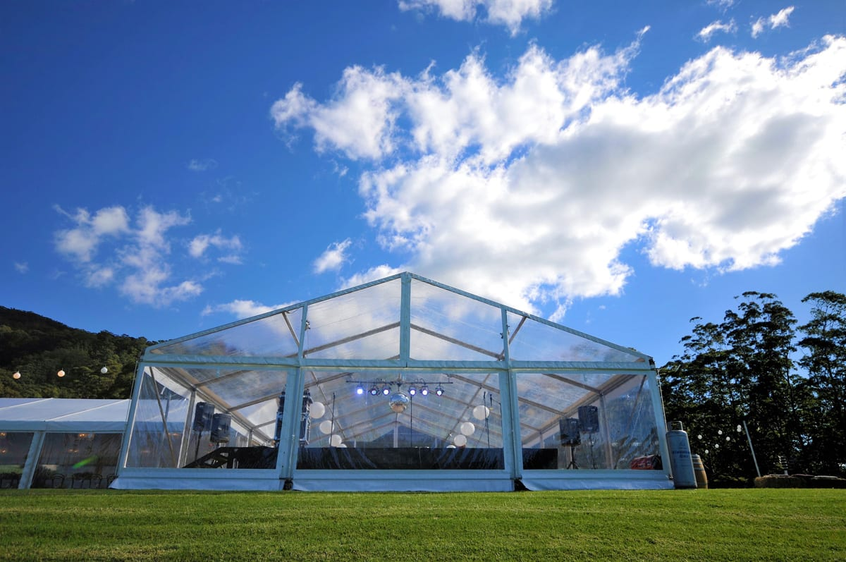 A HÖCKER P Series A-frame heavy duty party tent with a clear Poly-glass Roof for a music event