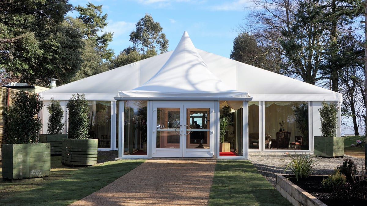 A HTS tentiQ GZ large party tent being used for wedding at a hotel