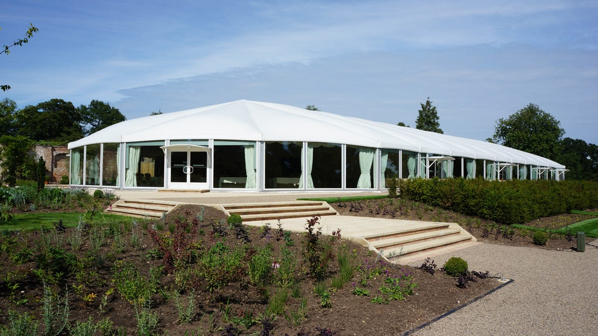 A HTS tentiQ GZ large event shaped tent for additional hosting space at a hotel