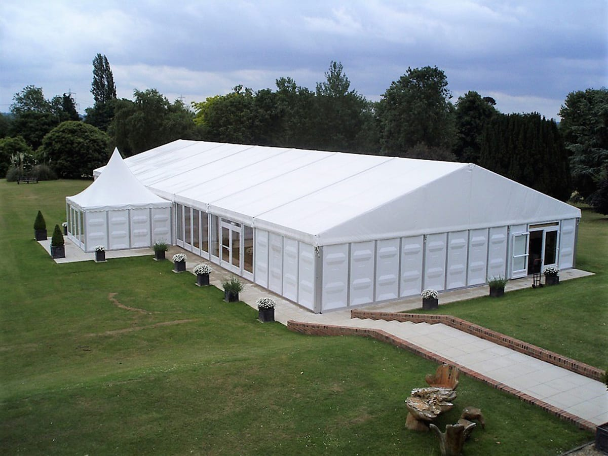 A HÖCKER F-Series large tent with a high peak roof component