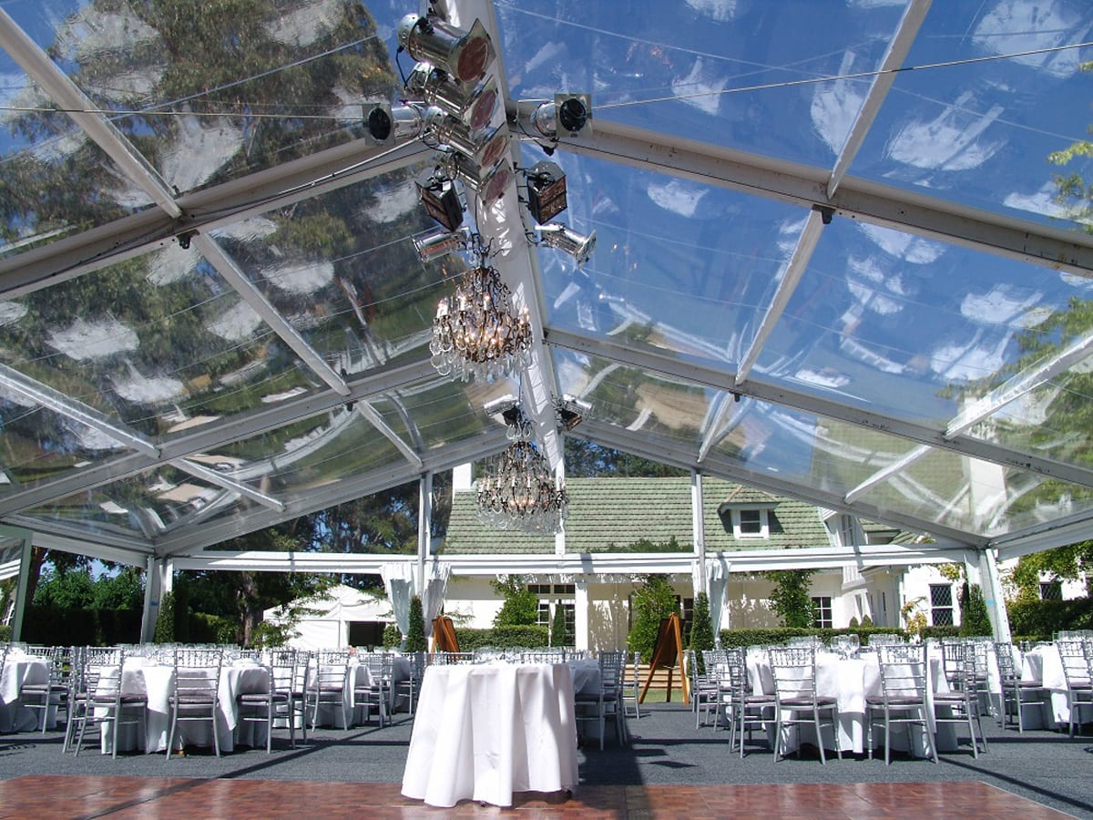 A HÖCKER F-Series large event tent for a wedding with a poly-glass roof