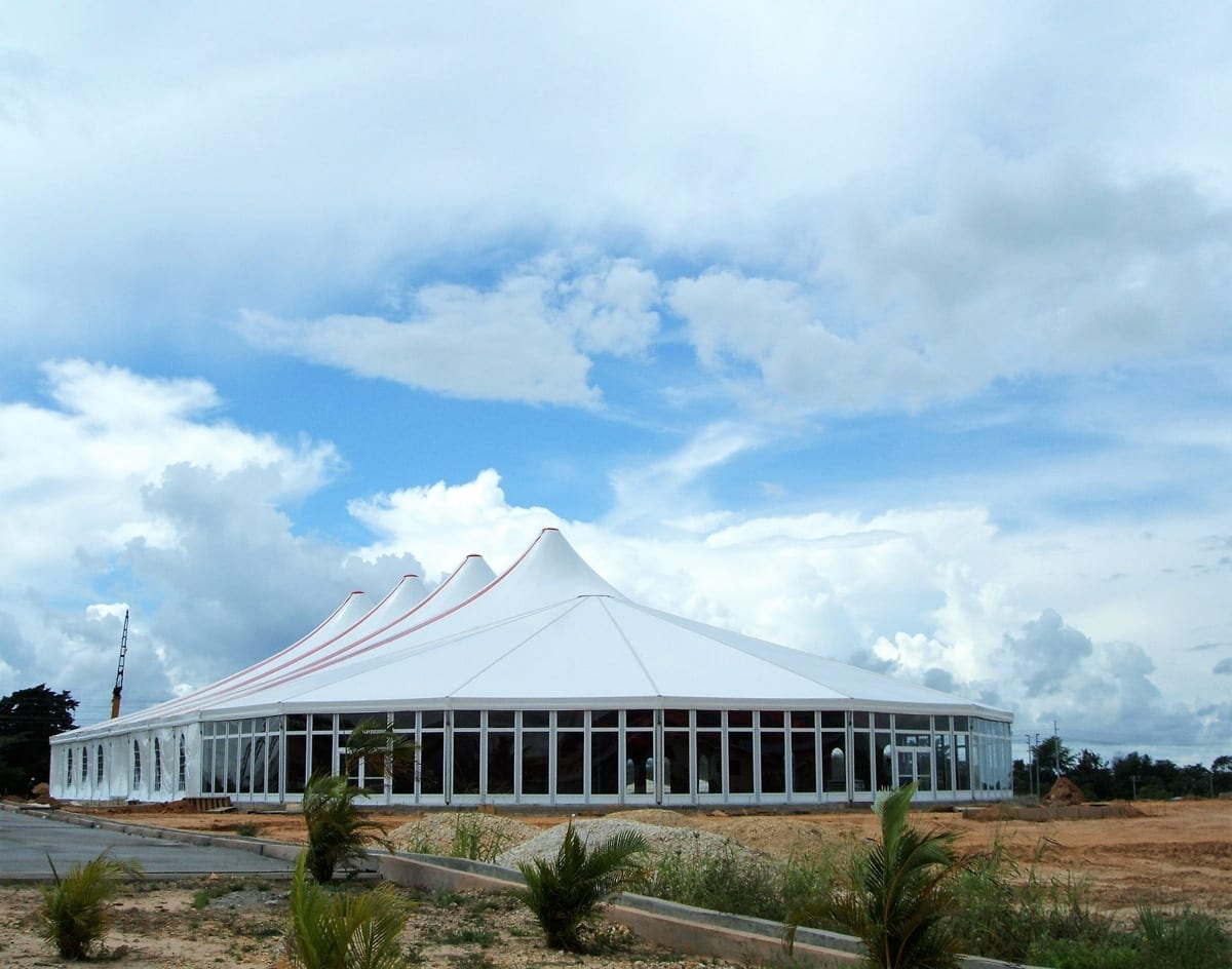 A HÖCKER F-Series large event tent with a hip end extension and high peak roof