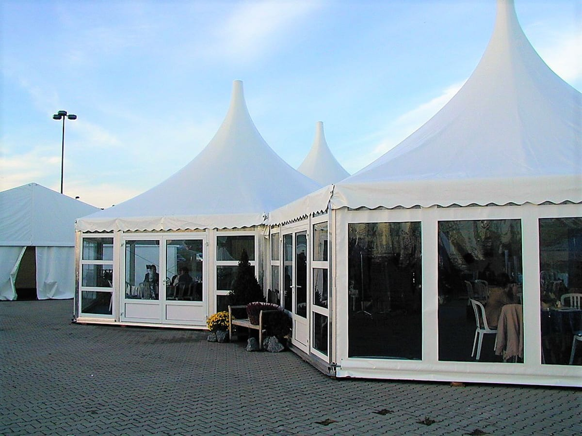 A HÖCKER P Series high peak roof multi sided tent being used at a function