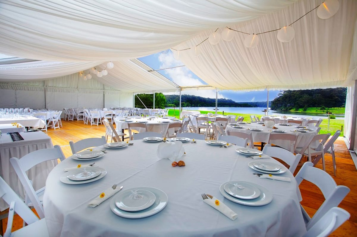 The interior of a HÖCKER P Series heavy duty party tent set up for a wedding