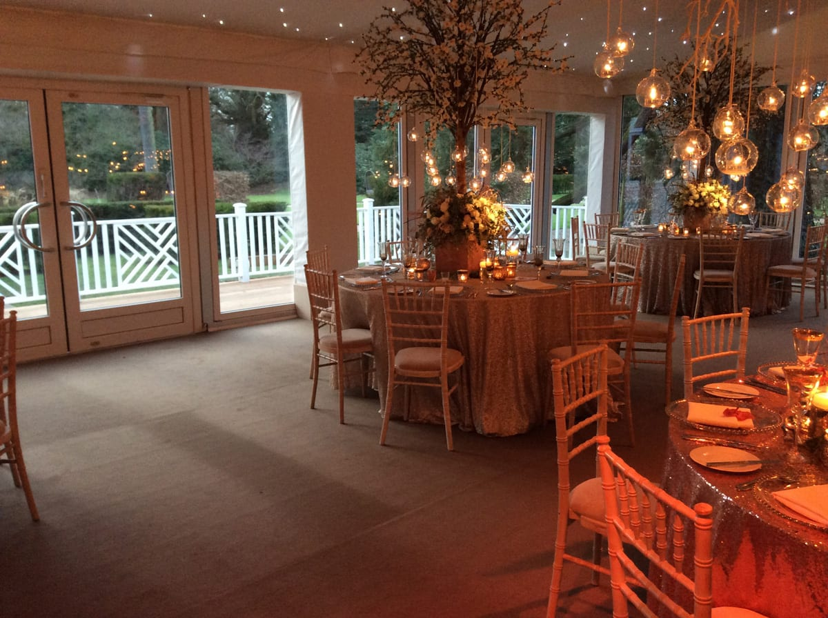The interior of a HÖCKER P Series event tent for a wedding with an exterior balcony