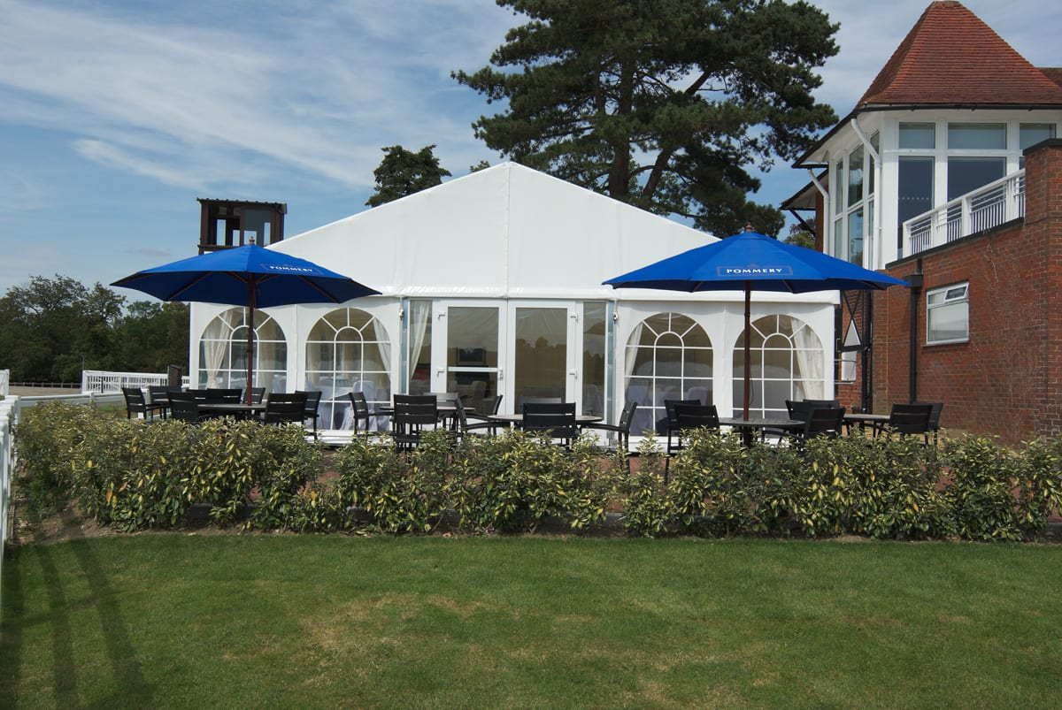 A HÖCKER P Series a-frame party tent with an outside seating