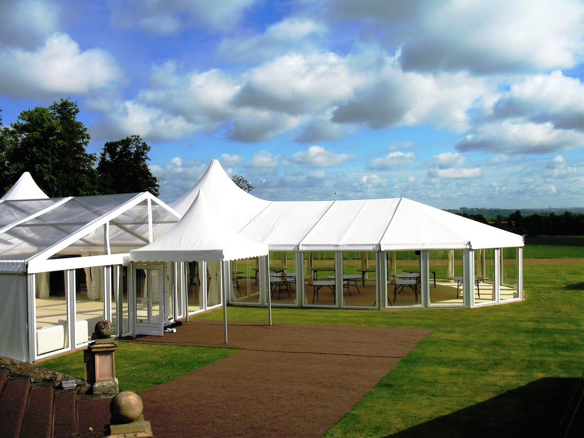 A HÖCKER P Series a-frame party tent with a poly-glass roof and a high peak tent extension for use at functions