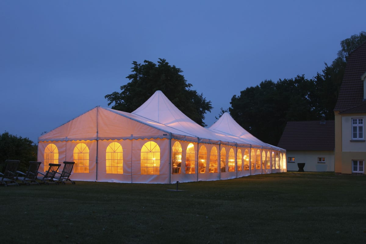 A HÖCKER P Series high peak roof event tent for being used at a function