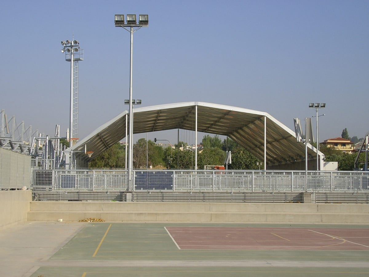 A sports cover structure for an outdoor multi-sports area