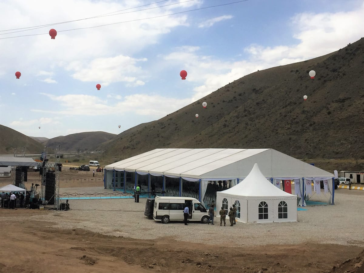 A large temporary clear-span tent for music event with additional small pagoda