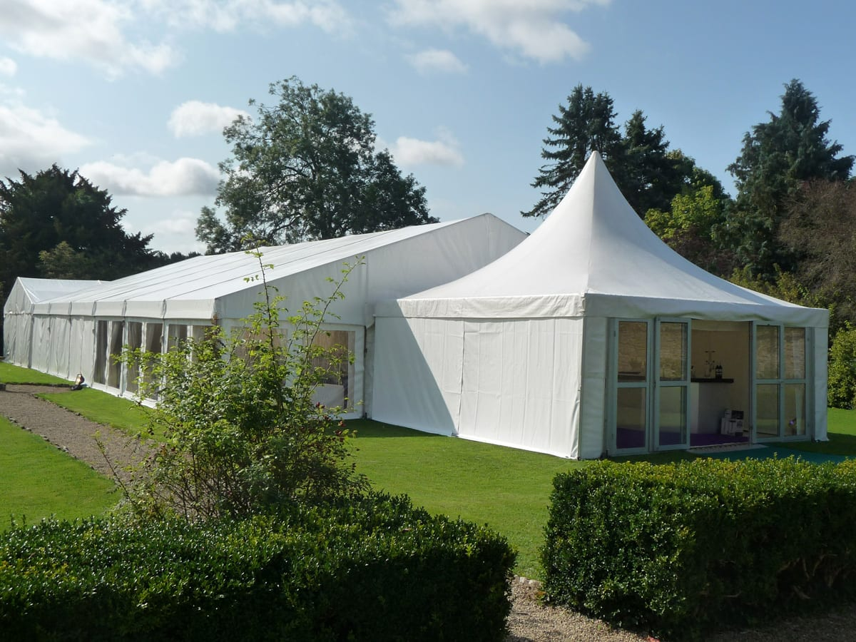 A Complete clear-span tent structure with a pagoda entrance component
