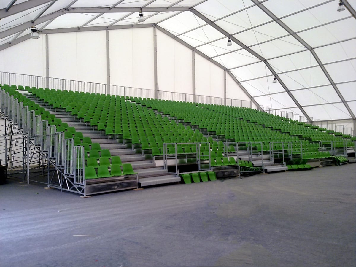 A seating area inside a temporary sports structure used for various sports and activities