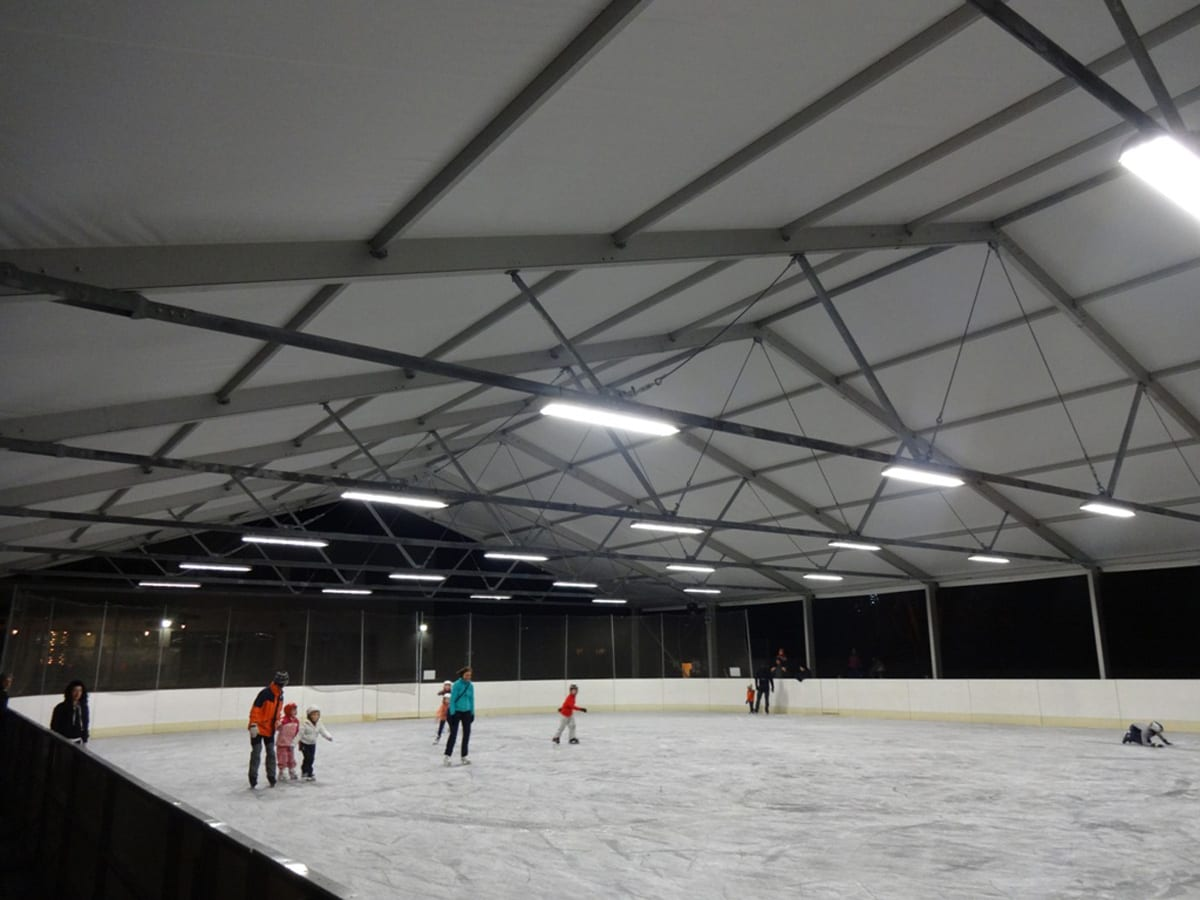 A Large sports structure canopy for an outdoor ice rink